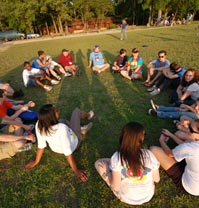 "Campers get together in a ""healing circle"" at Comfort Zone Camp."